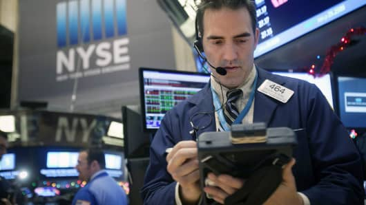 Traders work on the floor of the New York Stock Exchange, Dec. 29, 2014.