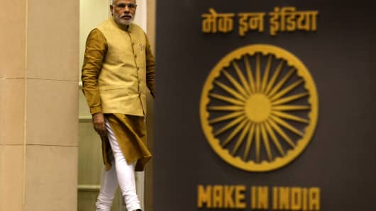 Prime Minister Narendra Modi arrives to unveil the logo at the launch of 'Make in India' campaign on September 25, 2014 in New Delhi, India.