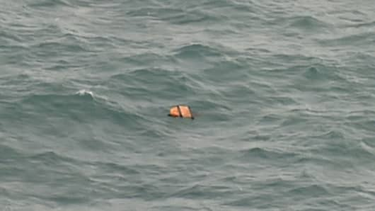 This aerial view taken from an Indonesian search and rescue aircraft over the Java Sea shows floating debris spotted in the same area as other items being investigated by Indonesian authorities as possible objects from missing AirAsia flight QZ8501 on December 30, 2014.