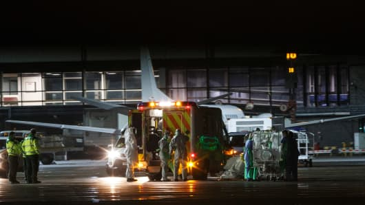 A volunteer nurse who contracted Ebola while working in Sierra Leone was airlifted from Scotland to a specialist clinic in London on December 30, 2014.