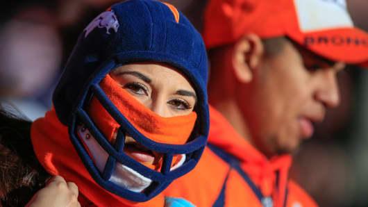 People in Denver bundled up for the cold.