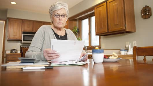 Mature woman looking at paperwork