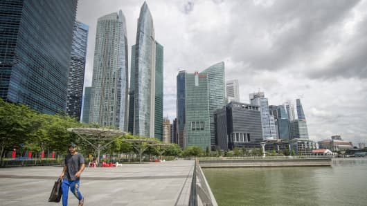 Buildings along the Singapore River are featured in this picture.