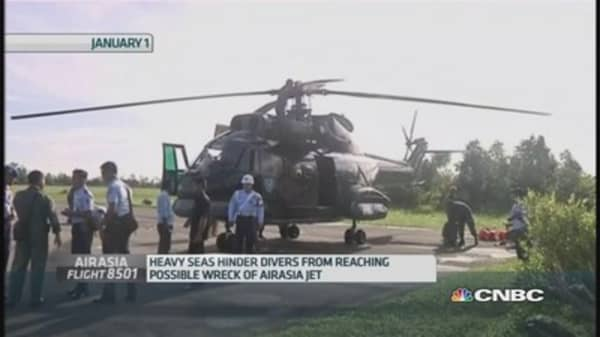 Bad weather hampers AirAsia search