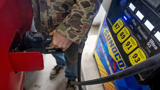 A customer pumps fuel at a Sunoco gas station in Rockbridge, Ohio, Dec. 17, 2014.
