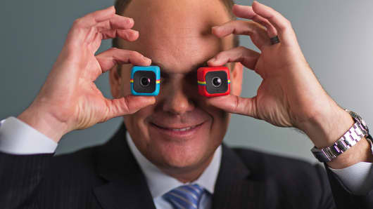 Polaroid CEO Scott Hardy holds the company's Cube digital cameras in London, Dec. 4, 2014.