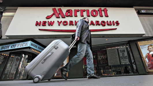 A pedestrian walks past the Marriott New York Marquis hotel, Feb. 11, 2009.