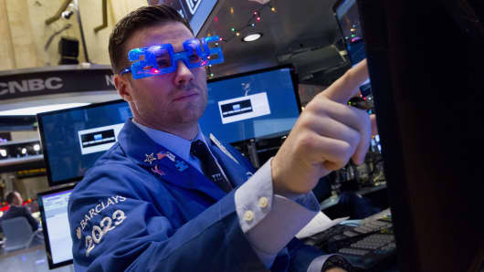 A trader works on the floor of the New York Stock Exchange on Dec. 31, 2014.