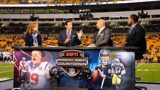 ESPN broadcasters talk on the set at Heinz Field before an NFL football game.