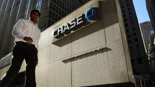 A man walks by One Chase Plaza in lower Manhattan