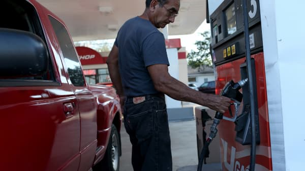 A customer puts gas into a vehicle at the U-gas station in Miami.