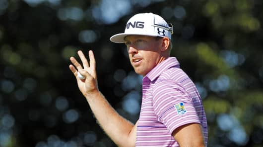 Hunter Mahan of the United States waves to the crowd after making a birdie on the 16th hole during the second round of the RBC Canadian Open at Glen Abbey Golf Club on July 26, 2013, in Oakville, Ontario.