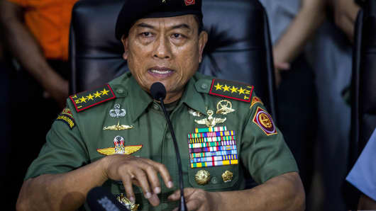 Indonesia Military Commander Moeldoko speaks during a press conference after a check up with the Indonesia military doing search and rescue for the AirAsia flight QZ8501 crash.
