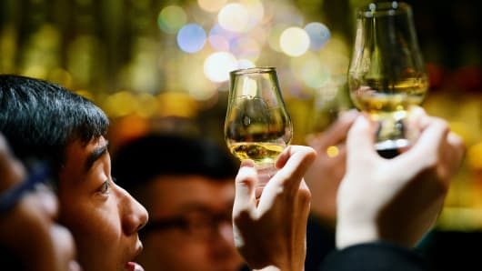 As Asia grows wealthier, its people are taking an interest in drinking and investing in whiskey.