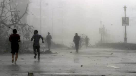 Cyclone Hudhud hit India's east coast, killing at least six people and leaving behind a trail of destruction in Andhra Pradesh and neighboring Odisha, on October 12, 2014 in Visakhapatnam.