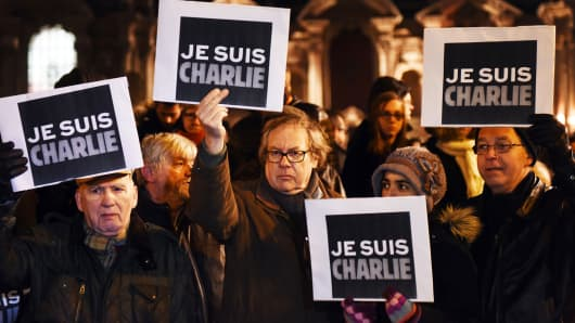 People hold placards reading in French 'I am Charlie' during a gathering in Lille, northern France, on January 7, 2015, following an attack by unknown gunmen on the offices of satirical weekly Charlie Hebdo.