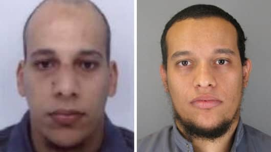 This combo shows handout photos released by French Police in Paris early on January 8, 2015 of suspects Cherif Kouachi (L), aged 32, and his brother Said Kouachi (R), aged 34, wanted in connection with an attack at the satirical weekly Charlie Hebdo in the French capital that killed at least 12 people.