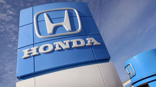 A sign is shown over the O'Hare Honda car dealership in Des Plaines, Ill.