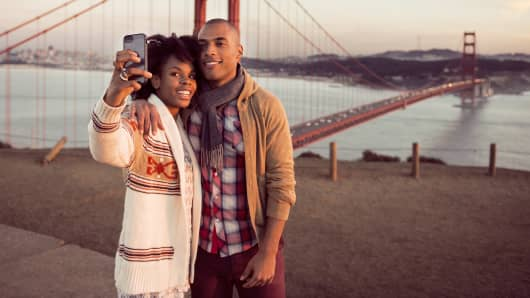 Couple taking selfie by Golden Gate Bridge