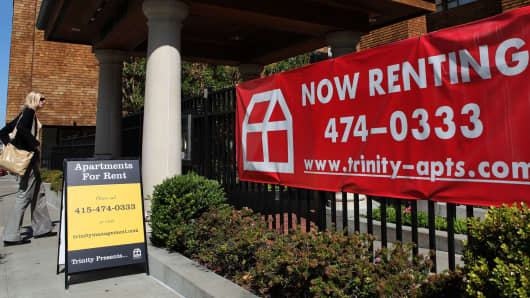 A banner and sign advertise apartments for rent in San Francisco.
