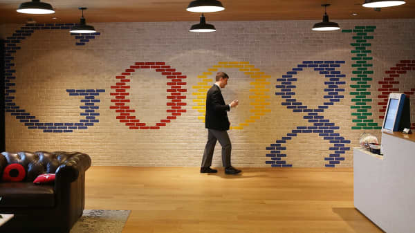 An employee walks through the lobby of Google's Washington, D.C., headquarters.