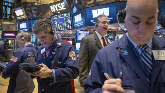 Traders work on the floor of the New York Stock Exchange, Jan. 8, 2015.