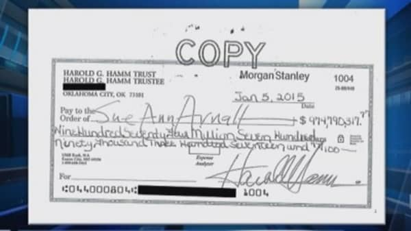 Hamm's ex-wife as cashed $975 million check: Sources