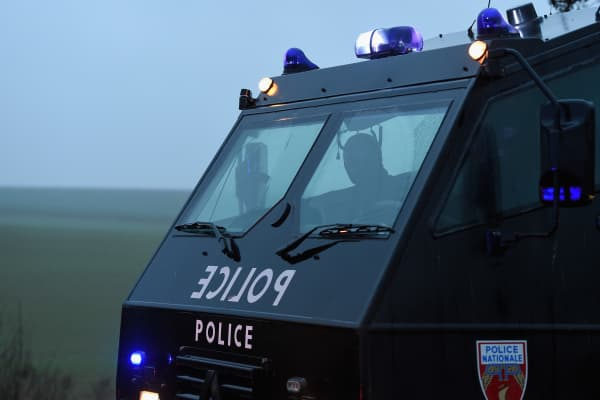 A special forces police officer drives an armored vehicle on January 9, 2015 outside Longpont, France