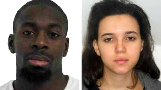 Pictured in this composite of handout photos provided by the Direction Centrale de la Police Judiciaire on January 9, 2015 are Amedy Coulibaly, aged 32, (L) who is confirmed dead by police in connection with the shooting of a French policewoman yesterday, and known associate Hayat Boumeddiene, aged 26 still at large.