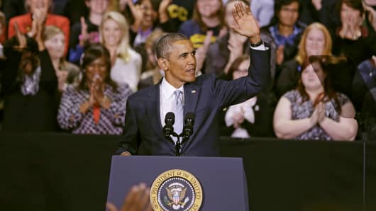 President Barack Obama waves to the audience as he arrives to speak at Pellissippi State Community College, Jan. 9, 2015, in Knoxville, Tenn.