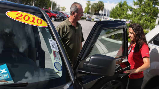 A man shops for used vehicles at the Toyota of Deerfield dealership in Deerfield Beach, Florida.