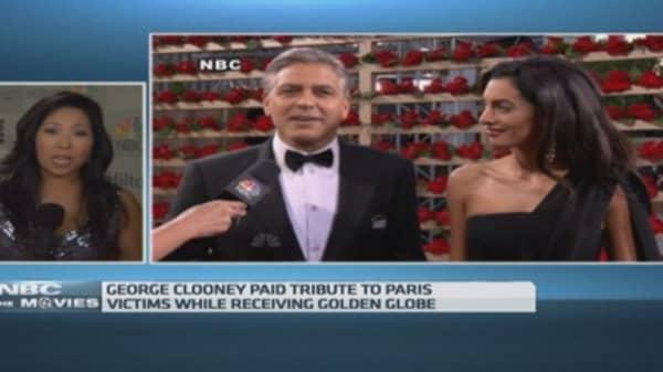 Golden Globes: Boyhood wins big as stars honor Paris shooting victims