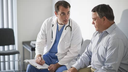 Doctor speaking to patient