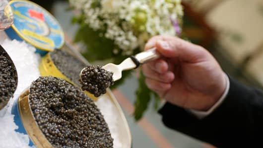 Presentation of Caviar with spoon on ice in St Petersburg