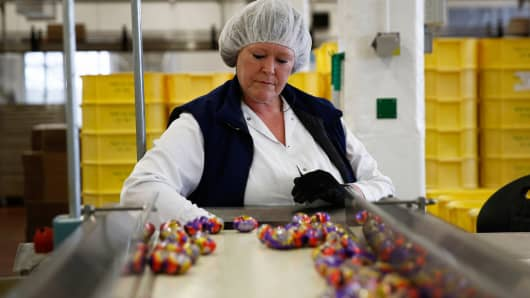 An employee monitors foil-wrapped Cadbury Creme Eggs as they move along the production line operated by Mondelez International, in Birmingham, U.K. last April.