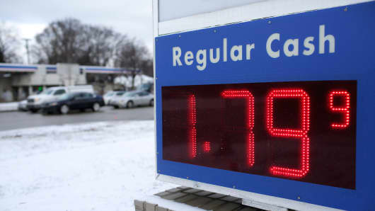 Regular gas cash price is displayed for $1.79 a gallon at a Mobil station January 6, 2015 in Livonia, Michigan.