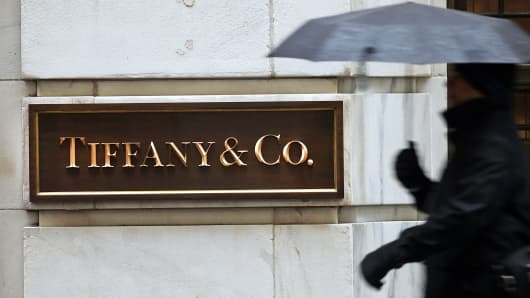 A pedestrian walks past a Tiffany & Co. store along Wall Street in New York, Jan. 12, 2015.