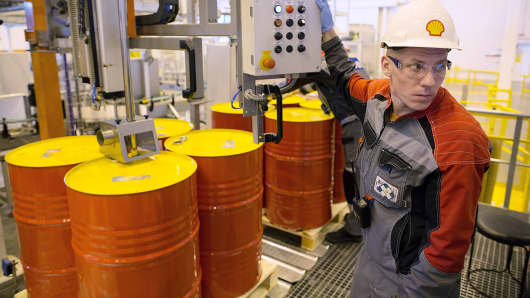 Barrels are filled with oil at a Royal Dutch Shell lubricants blending plant in Torzhok, Russia.