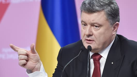 Ukraine's President Petro Poroshenko gestures during a news conference in Kiev, in this Dec. 29, 2014 photo.