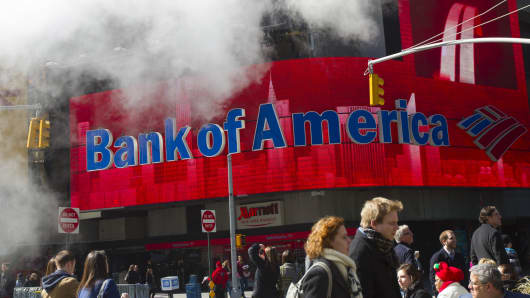 Pedestrians walk past Bank of America Corp. signage in New York.