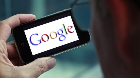 The Google logo is displayed on the screen of an iPhone.