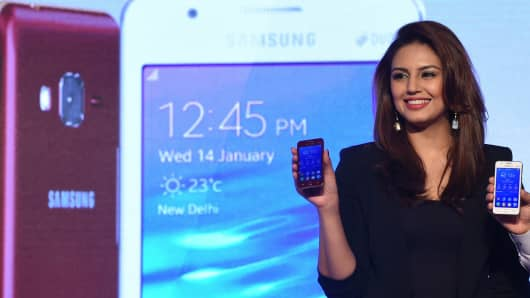 Indian Bollywood actress Huma Qureshi poses during the launch of the Samsung Z1 smartphone at a function in New Delhi on Jan. 14, 2015.