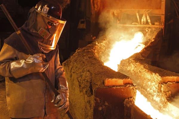 Worker in copper refinery