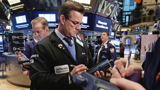 Traders work on the floor of the New York Stock Exchange, Jan. 14, 2015.