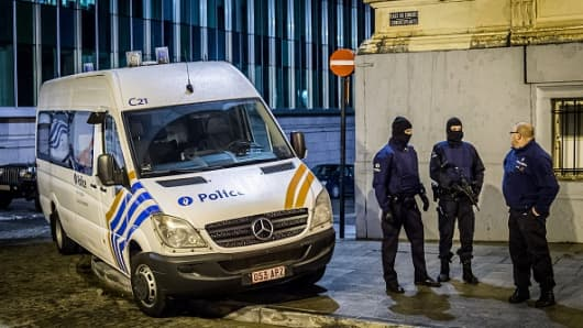 Belgian police stand near the Federal police building at Congress in Brussels