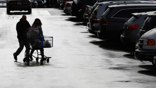 Shoppers in the parking lot of a Walmart store in Massachusetts.