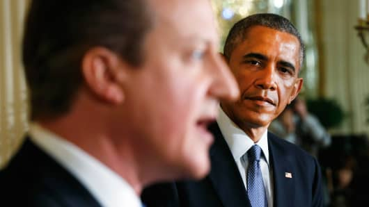 President Barack Obama listens to British Prime Minister David Cameron during a joint news conference at the White House in Washington, Jan. 16, 2015.