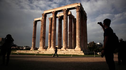Tourists visit the archaeological site of the Temple of the Olympian Zeus in Athens last November.