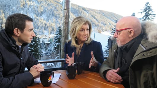 Andrew Ross Sorkin, Arianna Huffington and Paulo Coelho at Davos