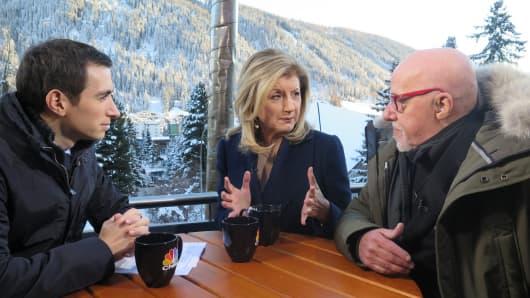Andrew Ross Sorkin, Arianna Huffington and Paulo Coelho at Davos